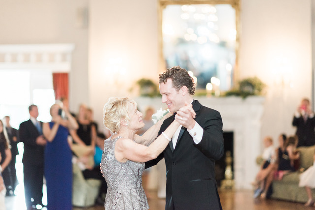 Mother and Groom Dancing During a Wedding Reception